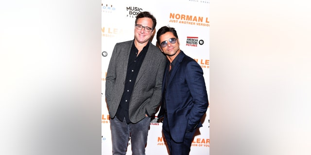 "Actors Bob Saget and John Stamos attend the Los Angeles Premiere of ""NORMAN LEAR: JUST ANOTHER VERSION OF YOU"" on July 14, 2016, in Los Angeles, California."