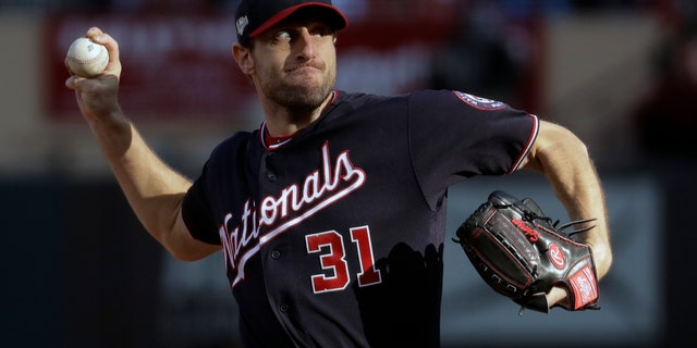 Washington Nationals starting pitcher Max Scherzer delivers during the fourth inning of Saturday's game. (AP Photo/Mark Humphrey)