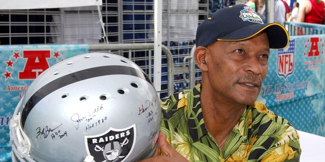 Willie Brown holds an autographed Riddell Raiders helmet at the Pro Bowl Footbal Festival at Kapiolani Park in Honolulu, Hawaii on Saturday, February 11, 2006. (Photo by Kirby Lee/Getty Images)
