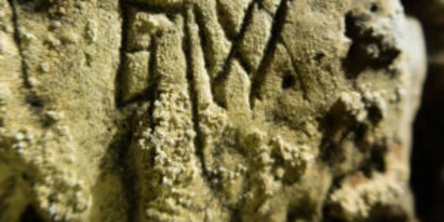 "The mysterious ""witches' marks"" on the cave in Creswell Crags in England."