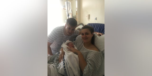 Ben Hayes, 28, with Callie Hayes, 22, holding newborn Teddy.