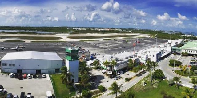 Police say the propeller of a plane at Key West International Airport took off a woman's arm and foot on Saturday.