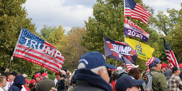"Pro-Trump flags ripple in the wind at the March for Trump rally Thursday. Rallygoers intended to send a message to Congress not to ""impeach"" their vote."