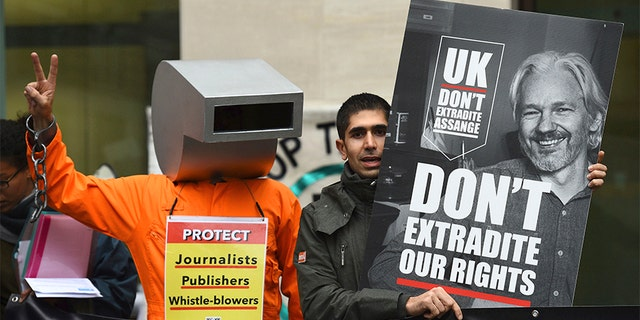 Supporters of Wikileaks founder Julian Assange demonstrate outside Westminster Magistrates' Court in London. (AP)