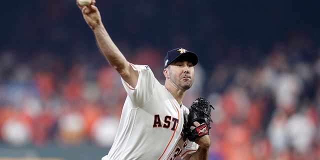 Houston Astros starting pitcher Justin Verlander (35) delivers a pitch against the Tampa Bay Rays in the first inning during Game 1 of a best-of-five American League Division Series baseball game in Houston, Friday, Oct. 4, 2019. (Associated Press)