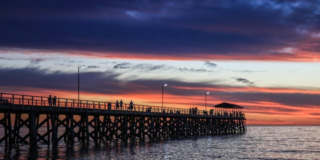 A dramatic sky with stunning colours during sunset over Grange beach in Adelaide (Amer Ghazzal/Barcroft Media via Getty Images)