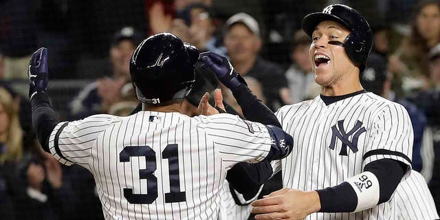 New York Yankees center fielder Aaron Hicks (31) celebrates with Aaron Judge after hitting a three-run home run against the Houston Astros during the first inning of Game 5 of baseball's American League Championship Series, Friday, Oct. 18, 2019, in New York. (Associated Press)