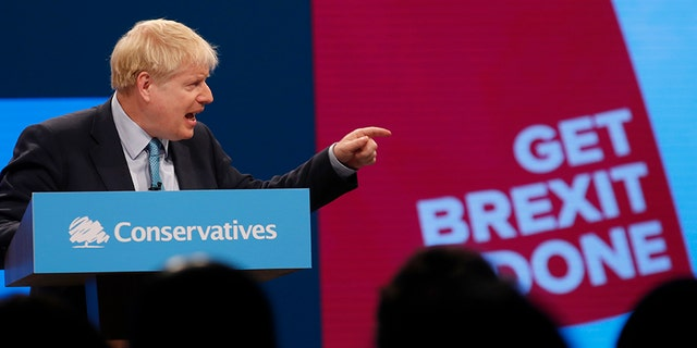 Britain's Prime Minister Boris Johnson delivers his Leader's speech at the Conservative Party Conference in Manchester, England, on Wednesday. (AP)