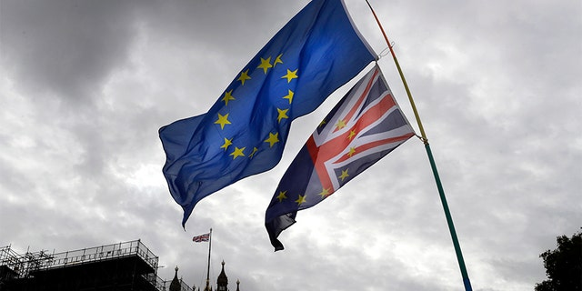 A European Union flag flies near Parliament in London on Tuesday. (AP)