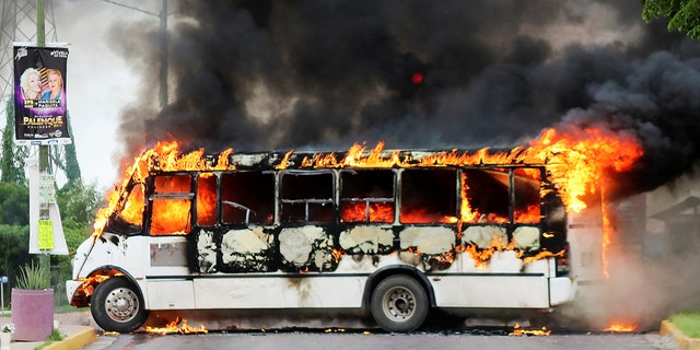 "A burning bus, set alight by cartel gunmen to block a road, is pictured during clashes with federal forces following the detention of Ovidio Guzman, son of drug kingpin Joaquin ""El Chapo"" Guzman, in Culiacan, Mexico, Oct. 17, 2019."