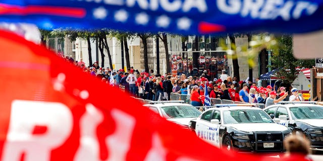 The line to enter a campaign rally for President Trump forming outside the American Airlines Center on Thursday in Dallas. (AP Photo/Jeffrey McWhorter)