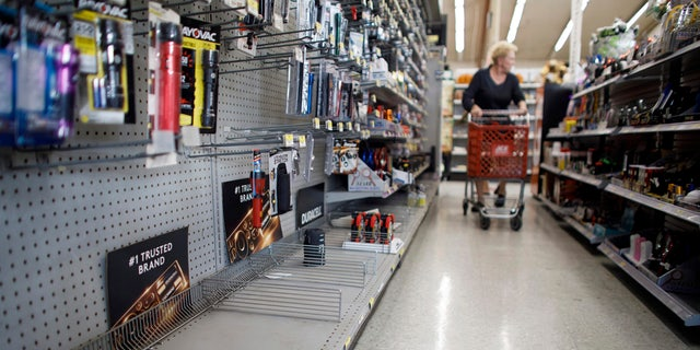The lantern section is nearly empty at an ACE Hardware store as shoppers prepare for possible power shutoffs in Los Gatos, Calif., Tuesday, Oct. 8, 2019.