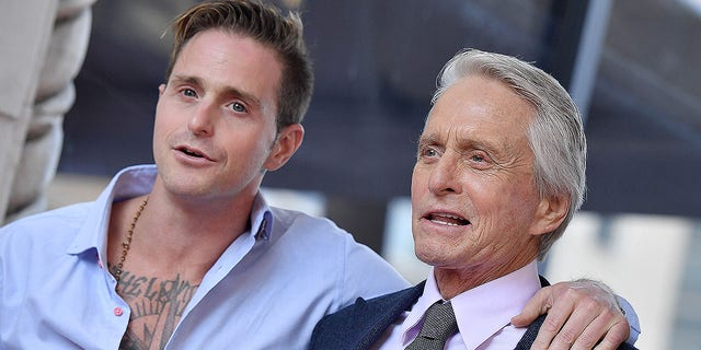 Cameron Douglas and Michael Douglas attend the ceremony honoring Michael Douglas with star on the Hollywood Walk of Fame on Nov. 06, 2018 in Hollywood. Cameron reflected on his Hollywood upbringing in a memoir being released in October 2019.