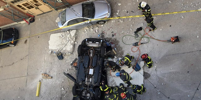 A 2013 Lincoln plowed past a fourth-floor parking garage barrier at City Market in Indianapolis, Ind., on Wednesday, killing two people inside.