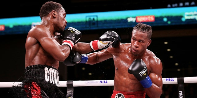 Charles Conwell (L) and Patrick Day exchange punches in the sixth round of their Super-Welterweight bout at Wintrust Arena on October 12, 2019 in Chicago, Illinois. (Photo by Dylan Buell/Getty Images)