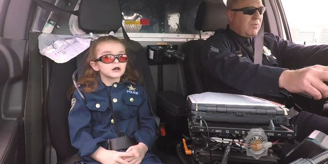 Media coverage showed 7-year-old Olivia Gant fulfilling a bucket list that included being a cop for a day