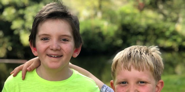 Oliver (left), pictured here with his brother, has undergone two bone marrow transplants.