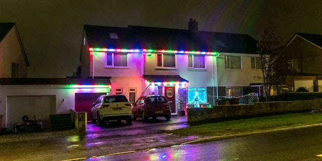 The outside of the family's home is currently decorated with lights and Christmas decorations.