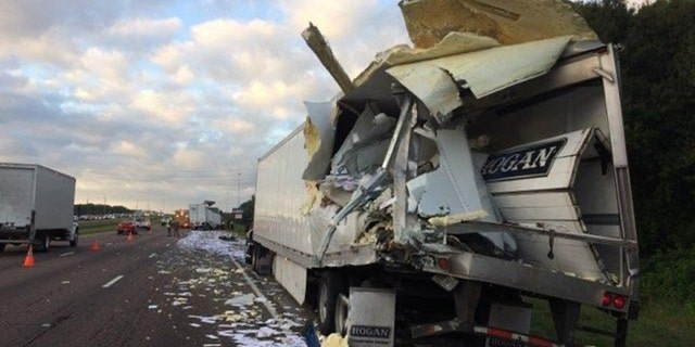 A tractor-trailer carrying mail on Monday crashed into another tractor-trailer on Interstate 75 in Florida, officials said.