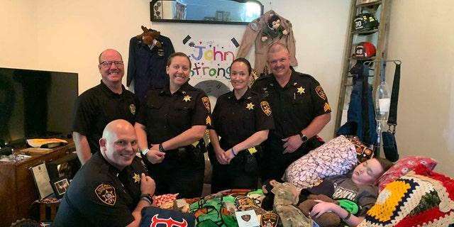 Clinton County Sheriffs visit John at home.