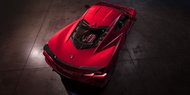 The Stingray coupe features a transparent engine cover in place of the convertible's tonneau.