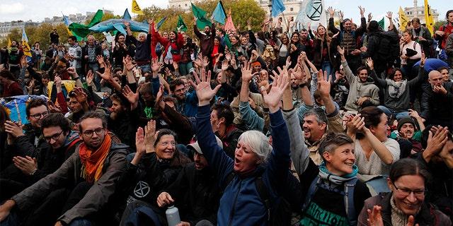 Protesters from Extinction Rebellion block a bridge Monday in Paris. (AP)