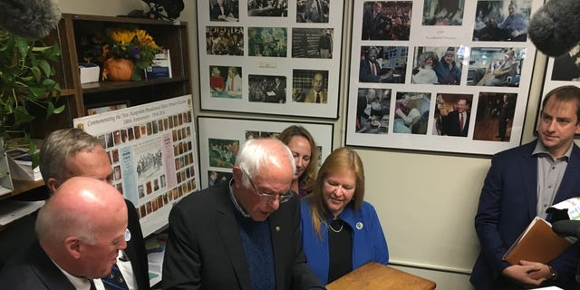 Democratic presidential candidate Sen. Bernie Sanders of Vermont signs the necessary paperwork to file to place his name on New Hampshire's first-in-the-nation presidential primary ballot. At the Statehouse in Concord, N.H., on Oct. 31, 2019
