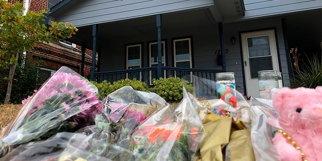 Bouquets of flowers and stuffed animals piling up outside the Fort Worth home on Monday, where a 28-year-old black woman was shot and killed by a white police officer.