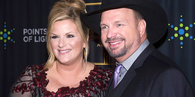 Trisha Yearwood and Garth Brooks attend the George H.W. Bush Points of Light Awards Gala at the Intrepid Sea, Air & Space Museum on Thursday, Sept. 26, 2019, in New York.