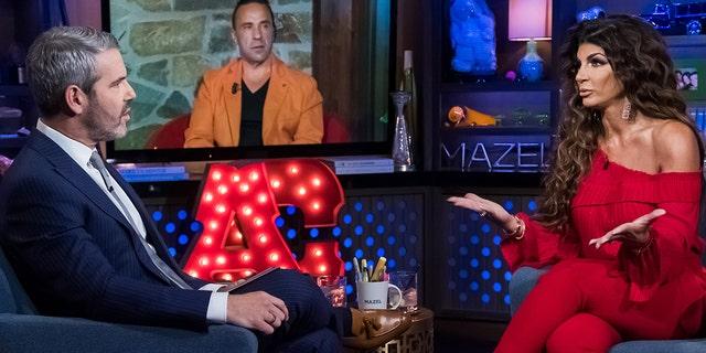 Andy Cohen, left, interviews Teresa Giudice, right, and Joe Giudice, center, joins in via satellite.