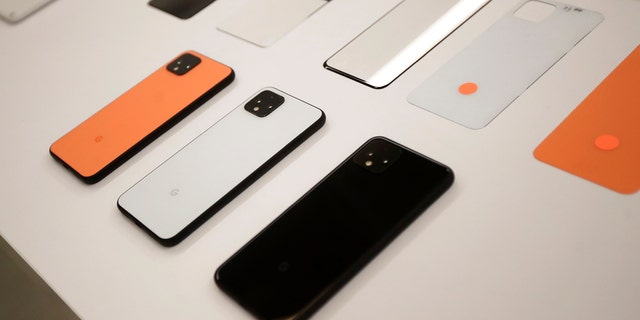 In this Tuesday, Sept. 24, 2019, photo New Pixel 4 phones are displayed at Google in Mountain View, Calif. (AP Photo/Jeff Chiu)