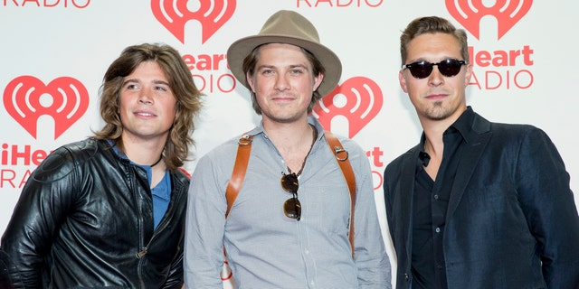 From left, Zac, Taylor, and Isaac Hanson, arrive at the iHeartRadio Music Festival at the MGM Grand Garden Arena in Las Vegas.