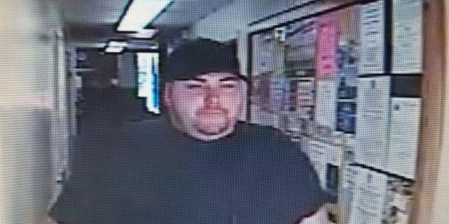 Investigators circulated an image of the robbery suspect whom they later identified as Heath Bumpous.