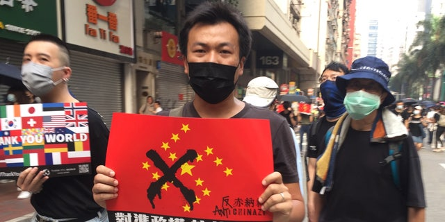 Tuesday's protest, coinciding with China's National Day, was described by officials as the worst for Hong Kong. Activists hurled gas bombs and rocks.Police responded with water cannons, rubber bullets and, in one case, a real one that injured a protester.
