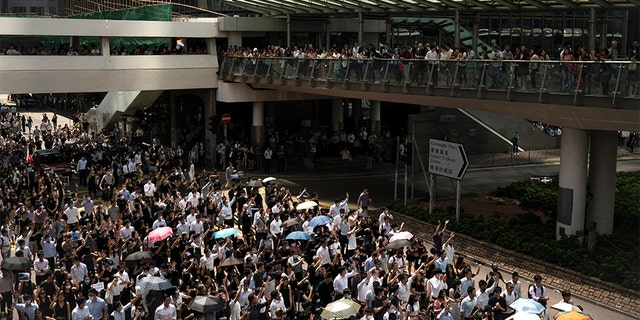 Anti-government protesters march at Central district in Hong Kong on Wednesday. (AP)
