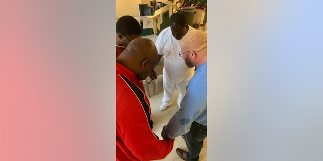 18 inmates were baptized Sunday at the W. Glenn Campbell Detention Center.