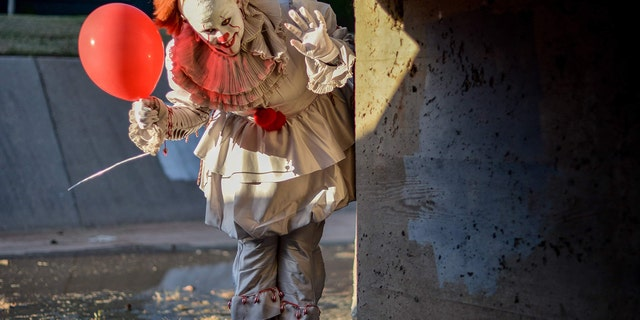 Maci Ann Tate dressed up as the clown Pennywise from the movie, while her boyfriend Jonathan dressed up as character Georgie.