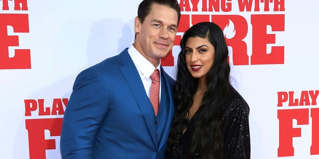 "John Cena and Shay Shariatzadeh went to the premiere of Paramount Pictures' ""Playing With Fire"" in October in New York. (Photo by Greg Allen/Invision/AP)"
