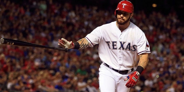 Josh Hamilton, a five-time MLB All Star and 2010 American League MVP, was charged Wednesday with injury to a child after his 14-year-old daughter told his ex-wife he had struck her at his Keller, Texas home. (USA Today Sports)