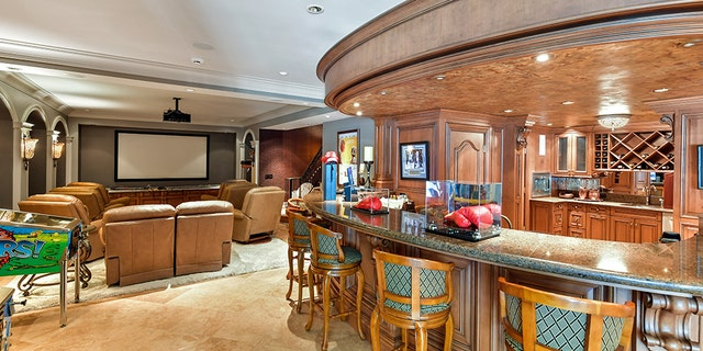 The property includes a media/game room complete with a sit-down bar area.