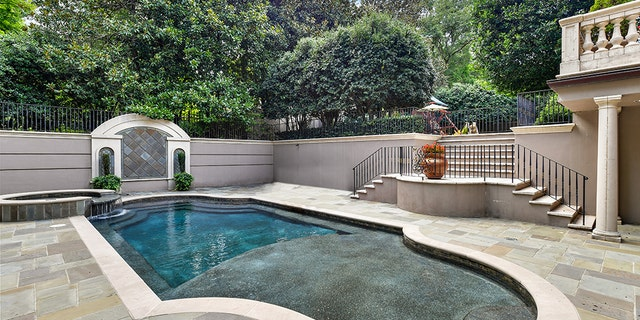 Theproperty includes an in-ground swimming pool with a large terrace and an enclosed play area on the side.