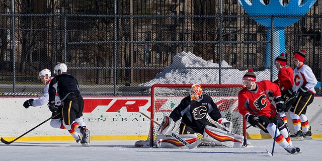 The NHL's Calgary Flames practice at Lasker Rink in New York's Central Park.