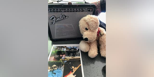 Employees at the Hard Rock Hotel at Universal Studios Orlando photographed Special Dog enjoying his extra vacation time, and send the pics along to Millie.