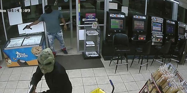 Two suspects, including one wearing an alien mask, were involved in the fatal shooting of a gas station clerk on Monday, according to Houston police.