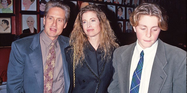 Michael Douglas and then-wife Diandra posing with son Cameron Douglas in 1993. Michael and Diandra have since divorced. He later married Catherine Zeta-Jones.