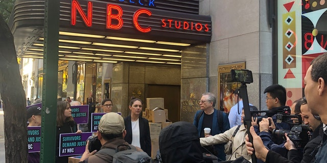 Protesters rallied outside NBC News headquarters in New York City on Tuesday.