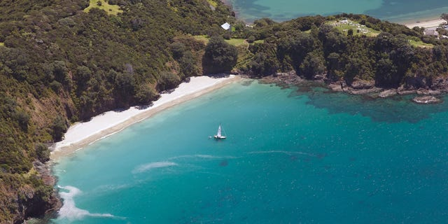 An aerial view of the Bay of Islands, North Island, New Zealand. The Bay of Islands boasts a unique coastline sheltering over 150 small islands in its arms.
