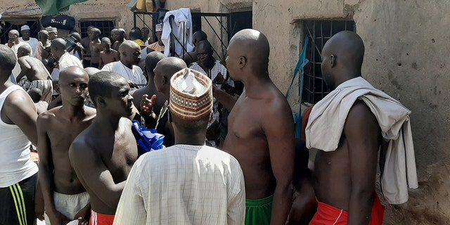 People are pictured after being rescued by police from the suspected Islamic school in Katsina, Nigeria.