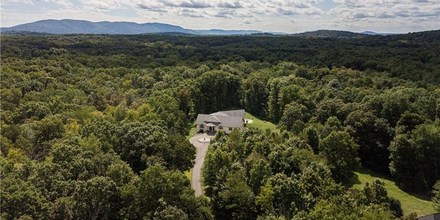 The cinema of a $2.79 million, four-bedroom, five-bathroom home in shaggy Wappingers Falls, New York, starts like any otherlistingonline.