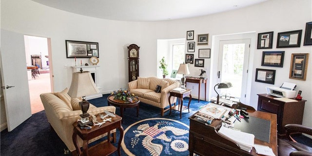 """The residence facilities asmaller-scale reproduction of a Oval Office, modeled after how it looked on """"The West Wing."""""""